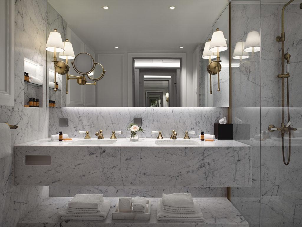 A deluxe room at Britannia hotel with Carrera marble bathroom