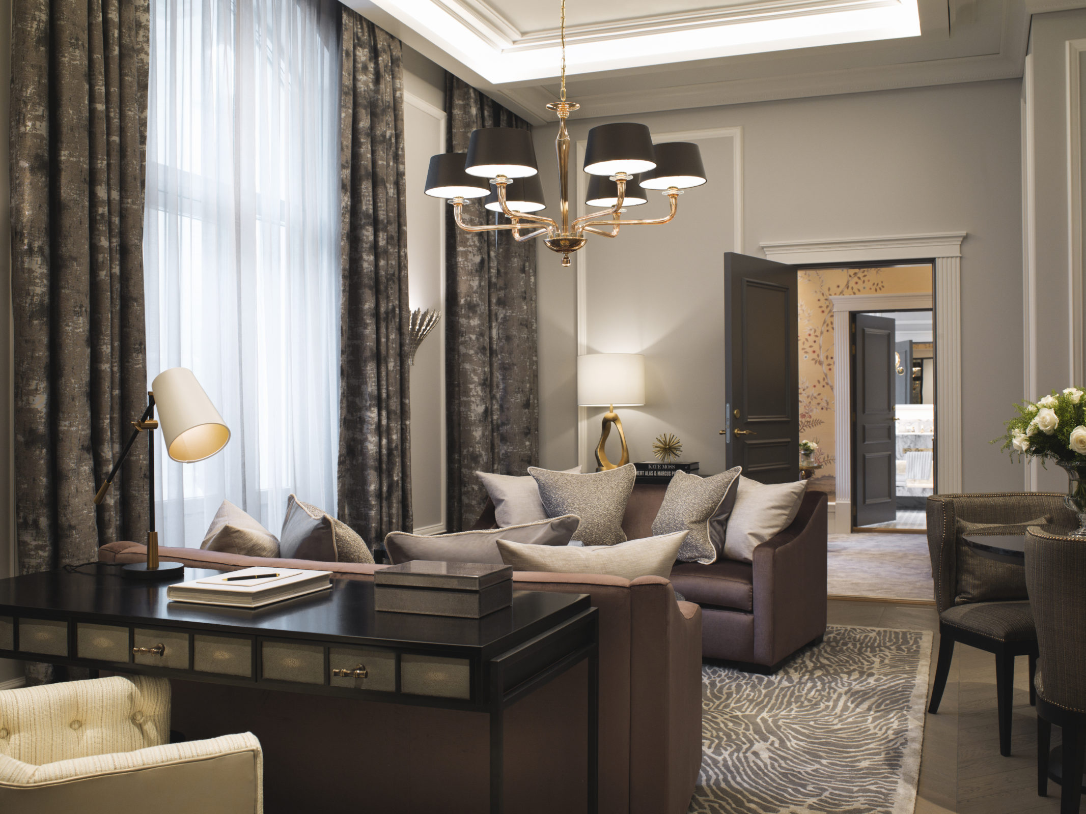 Britannia Hotel in Trondheim's Signature Suite styled by Metropolis Interior Architects. Living room and entertainment area, with bedroom and bathroom in the background