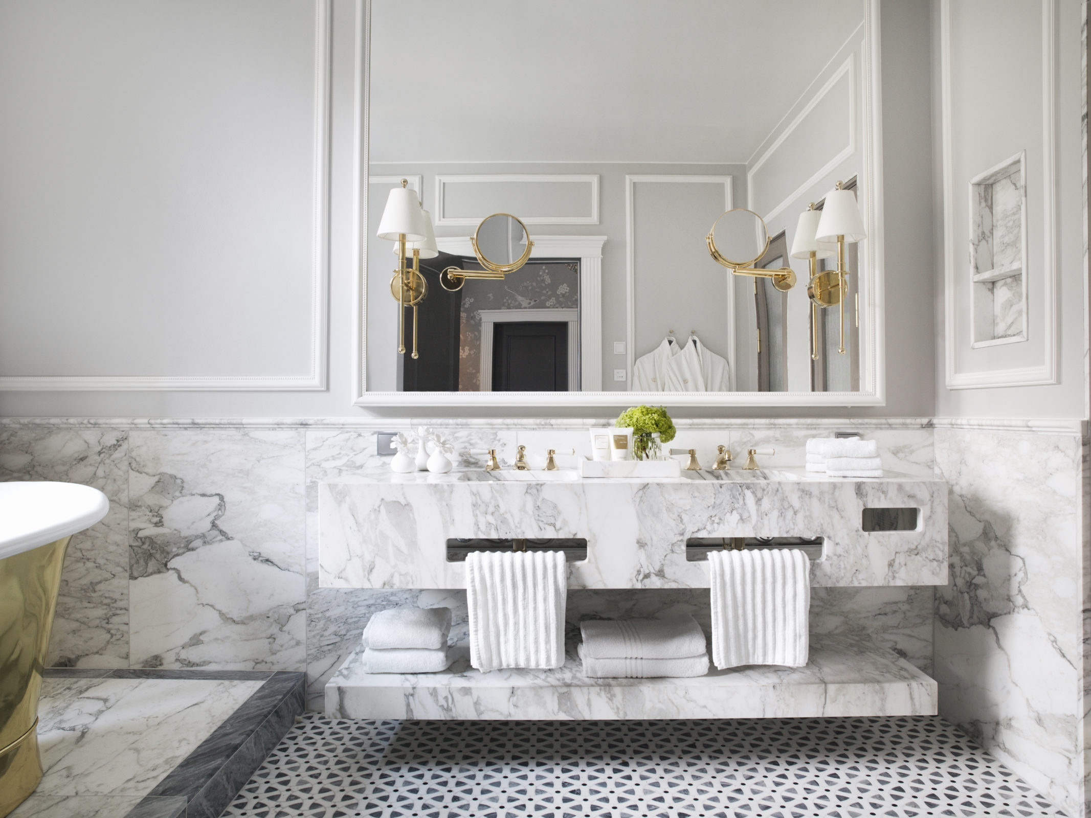 Britannia Hotel in Trondheim's Signature Suite styled by Metropolis Interior Architects. Master en-suite bathroom., with Carrera marble throughout.