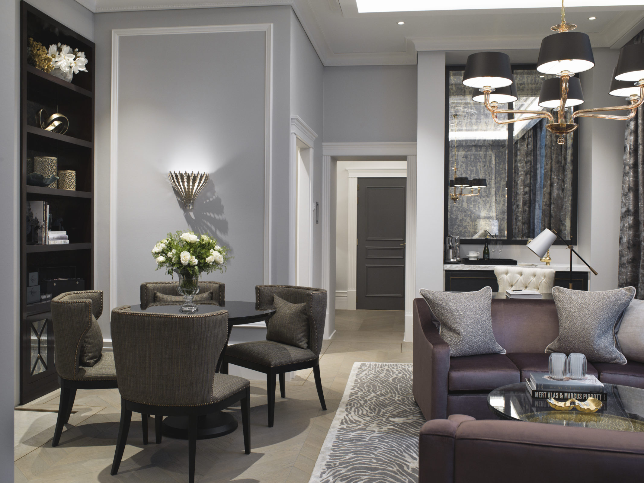 Britannia Hotel in Trondheim's Signature Suite styled by Metropolis Interior Architects. Living room and entertainment area, with entrance hallway and adjoining suite in the background.