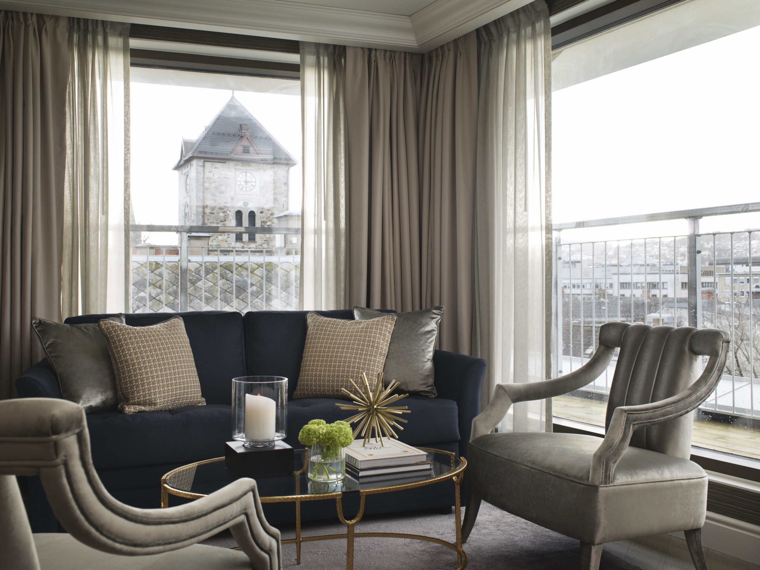 Britannia Hotel in Trondheim's Executive Suite styled by Metropolis Interior Architects. Living room with view over Trondheim and Vår Frue Kirke.