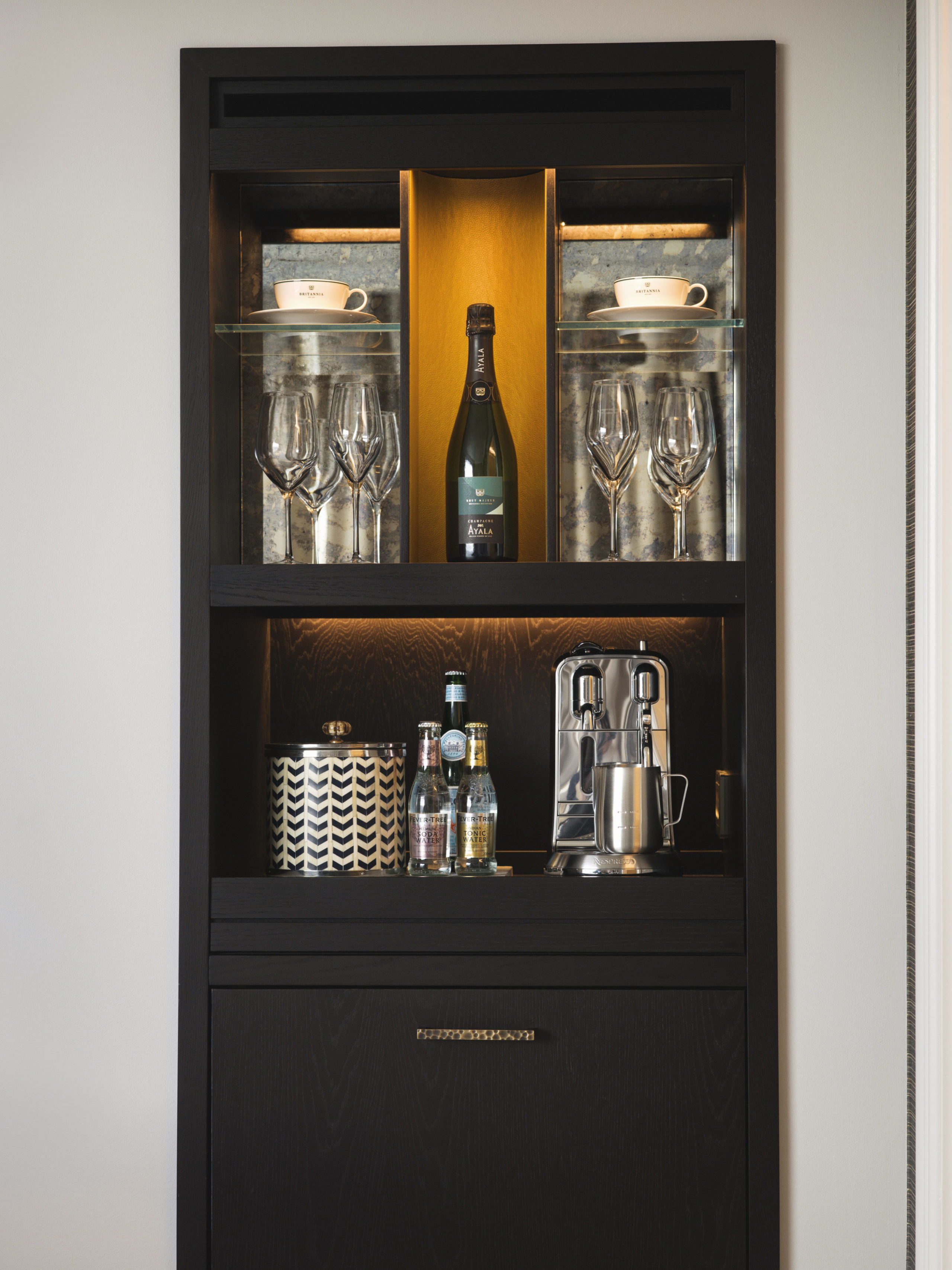 Britannia Hotel in Trondheim's Executive Suite styled by Metropolis Interior Architects. Bar and amenities in iving room.