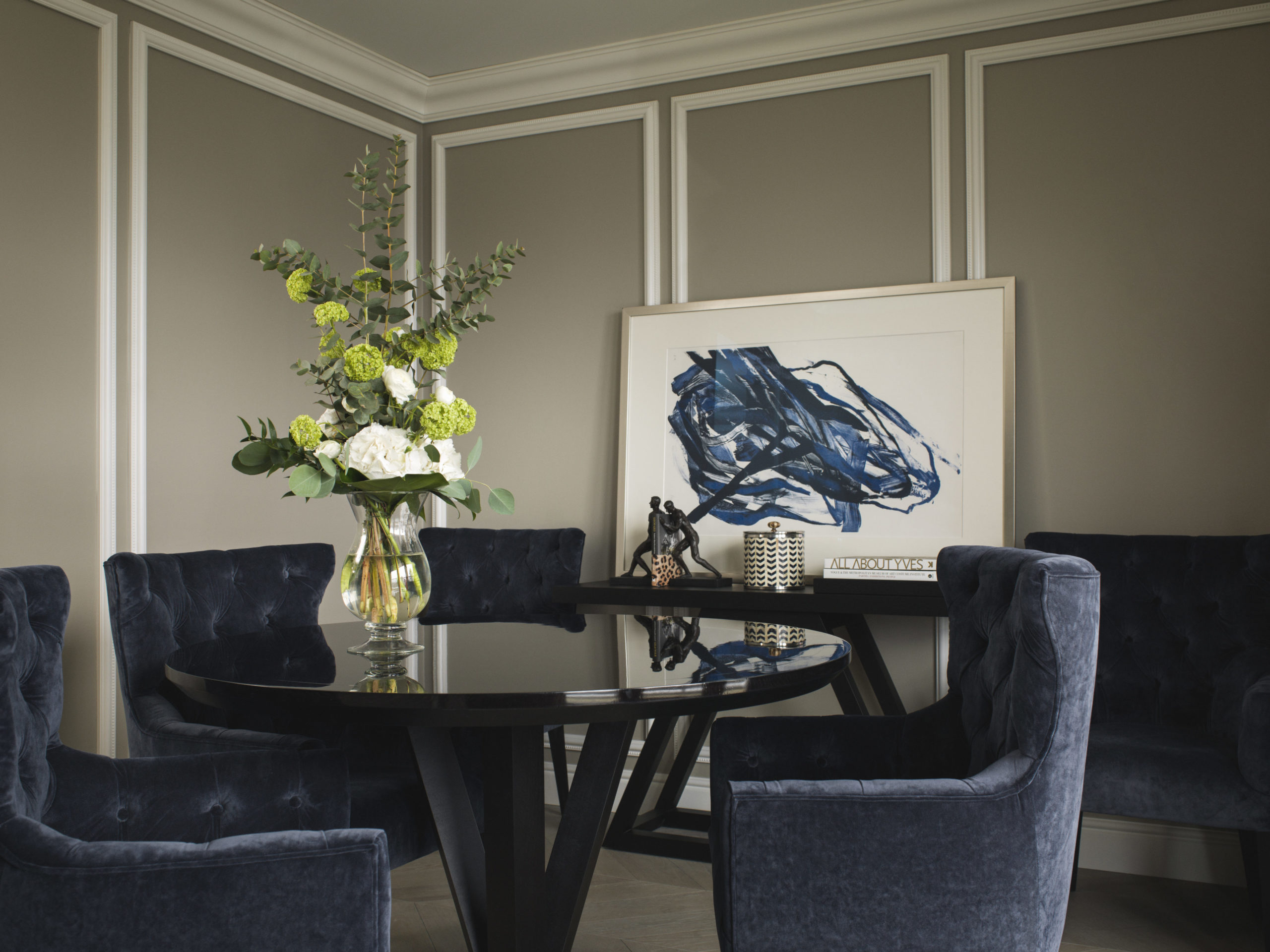 Britannia Hotel in Trondheim's Executive Suite styled by Metropolis Interior Architects. Dining area with flowers and artwork.
