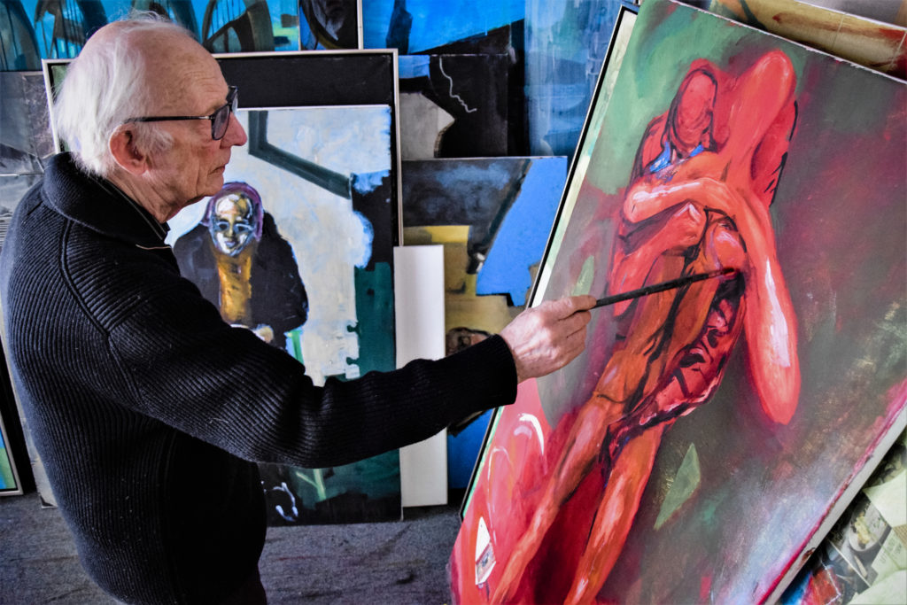 Artist Håkon Bleken painting in his studio