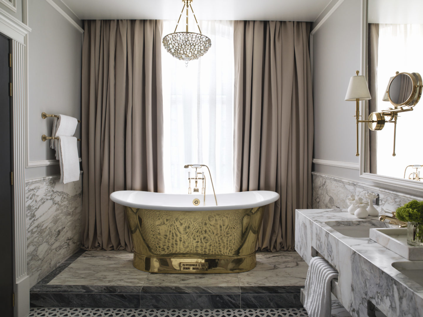 Britannia Hotel in Trondheim's Signature Suite styled by Metropolis Interior Architects. Master en-suite bathroom. Gold plated bath tub by Catchpole & Rye, from Kent in England.