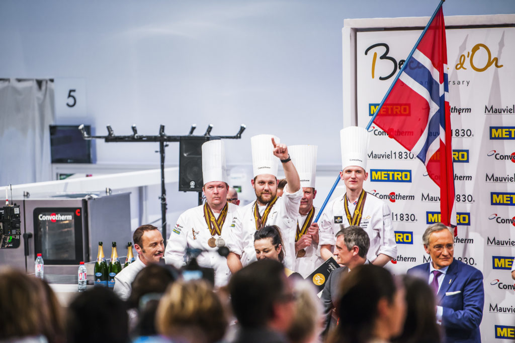 Photo of Christopher Davidsen celebrating winning silver in the Bocuse D'Or gastronomy competition in Lyon 2017.