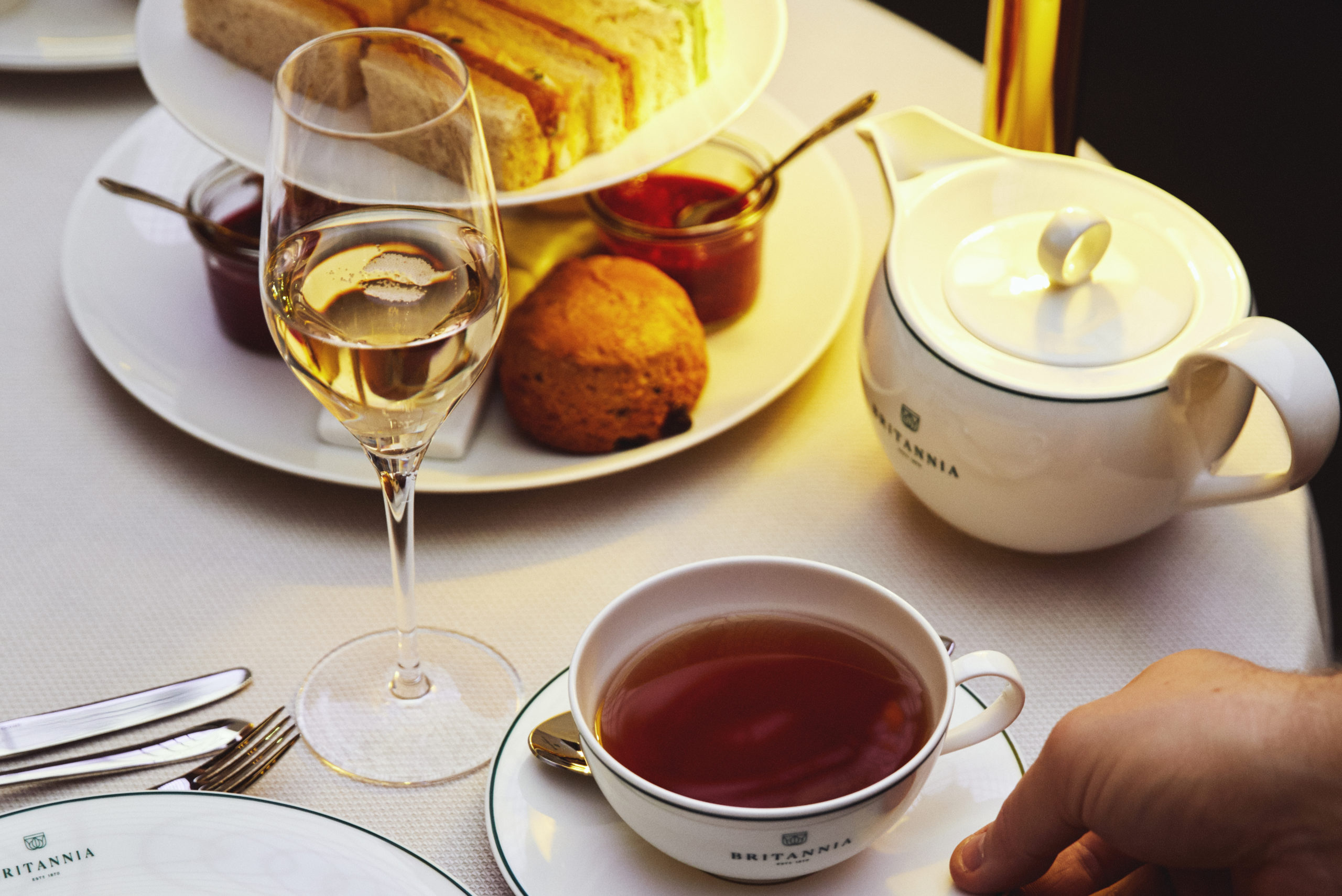 a serving of Britannia Hotel afternoon tea in palmehaven, with champagne and scones