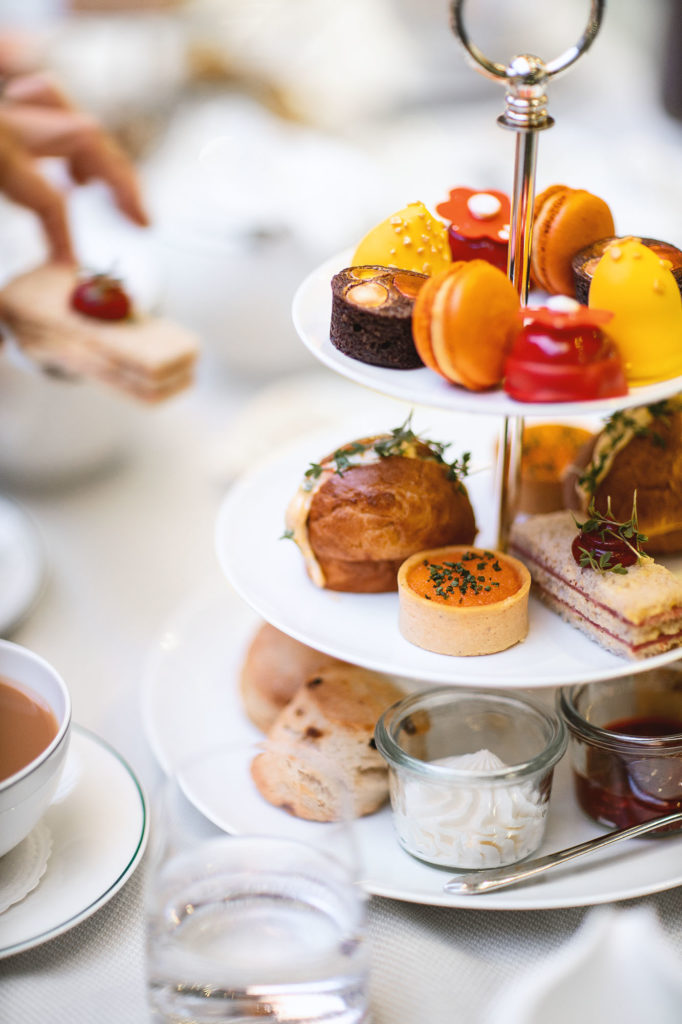 Tiered cake stand with sweet and savoury delights at Britannia Hotel's signature Afternoon Tea, served in the iconic Palmehaven.