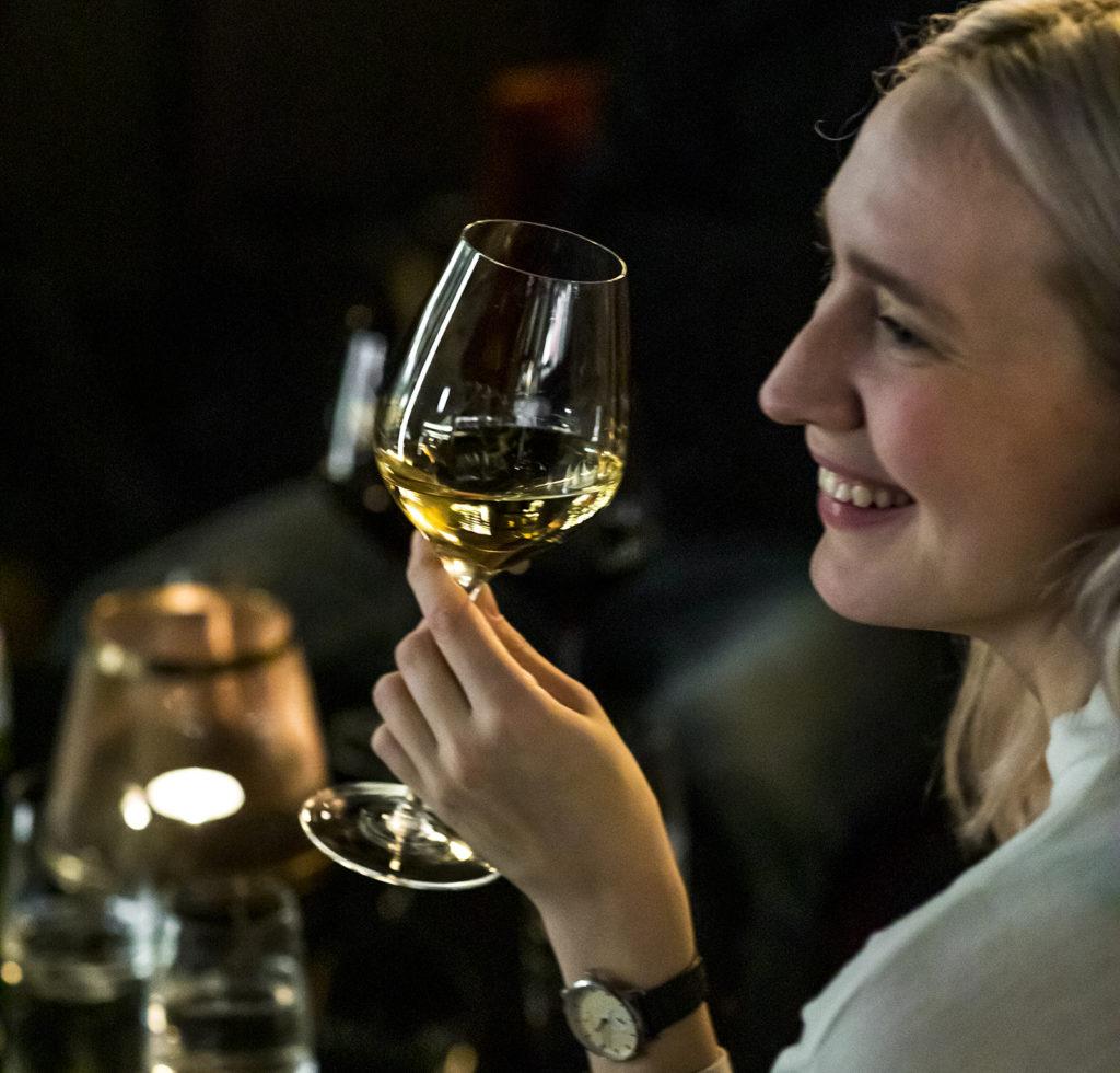 lady enjoying a glass of white wine in Britannia Hotel's Vinbaren