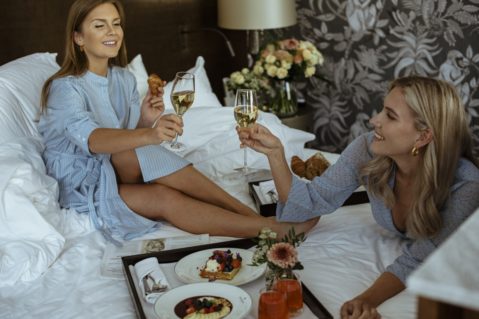 Two ladies dining in bed at Britannia Hotel