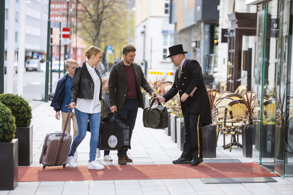 photo shows family arriving and demonstrates the five star service if Britannia Hotel