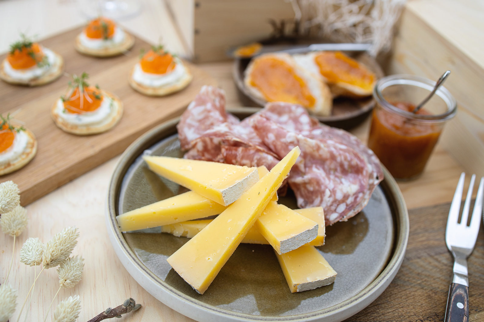 A spread of hams, cheeses, blinis and marmelade, as found in the Weekend pack at Vinbaren's Delicatessen, located at Britannia Hotel in Trondheim, Norway.