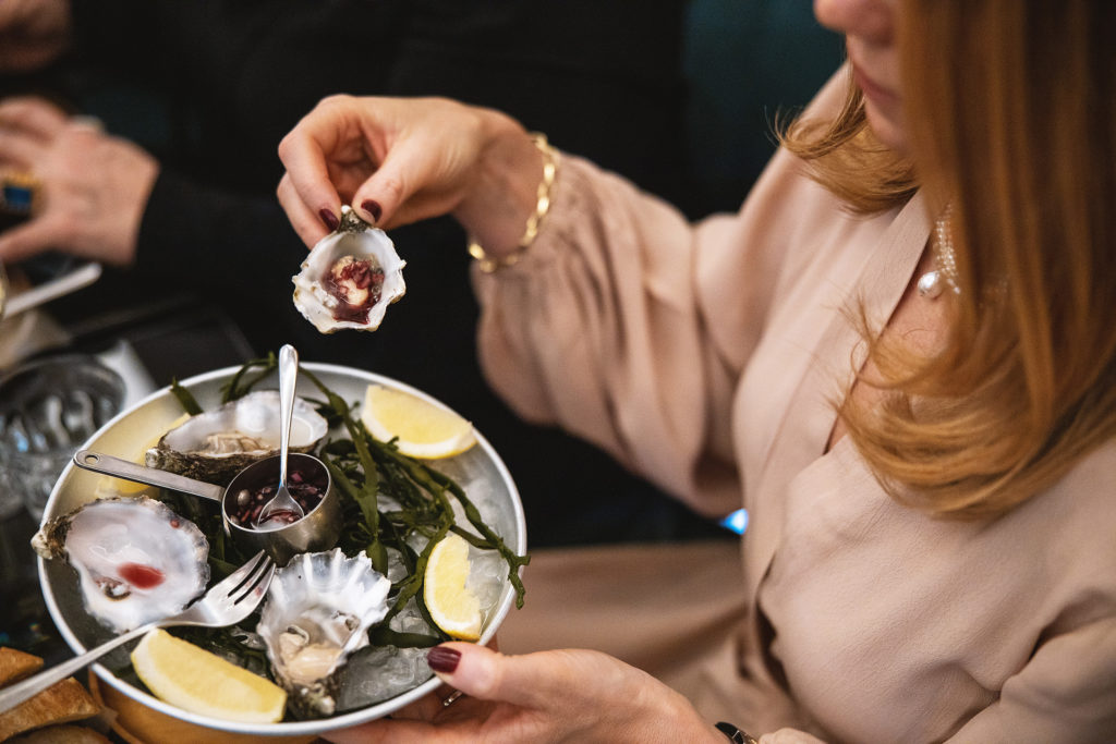eating oysters in Brasserie Britannia