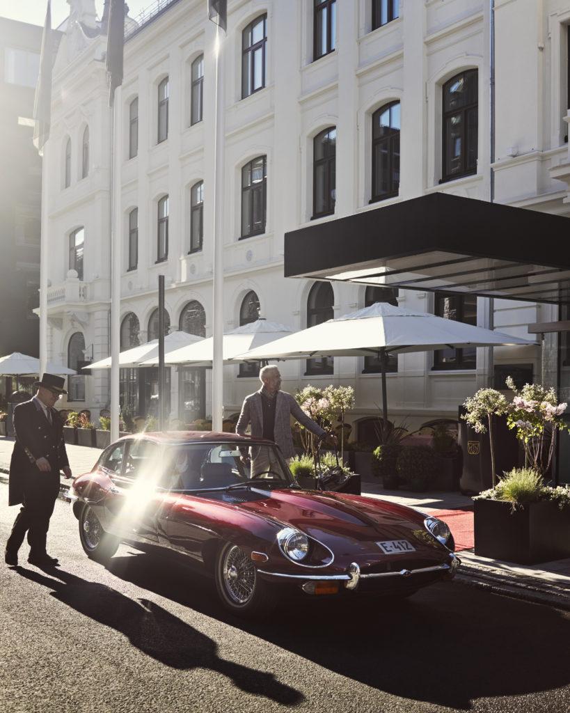 man arriving at Britannia Hotel in classic car
